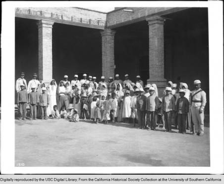 1910A_group_of_about_fortyfour_women_and_children_Yaqui_Indian_prisoners_under_guard_Mexico_ca1910 copy